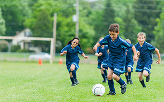 Youth-soccer-team-boy-kicking-ball