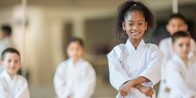 Kids at a YMCA martial arts class