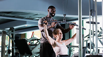 Active Older Adult with a Personal Trainer - YMCA Personal Trainer