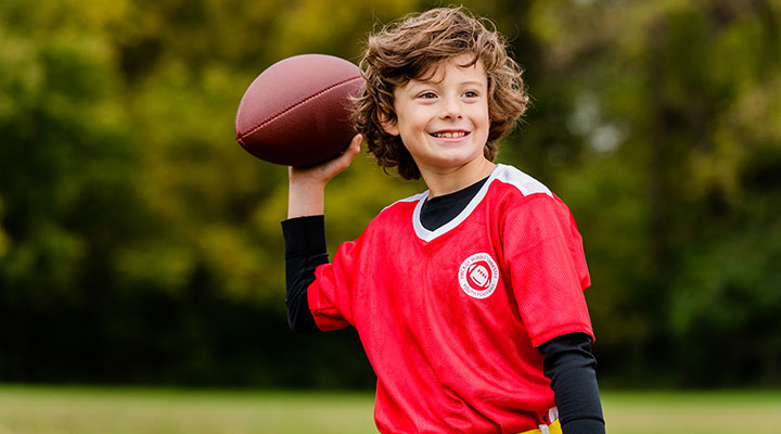 Boy at YMCA flag football