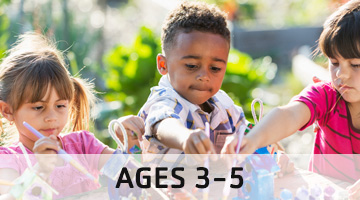 YMCA Camp Little Y for ages 3-5, young children painting outside
