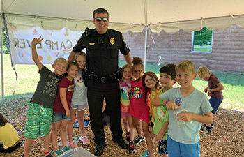 Officers visiting kids