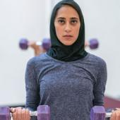 Muslim woman with weights
