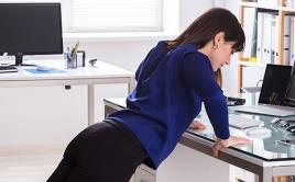 Woman working out at desk